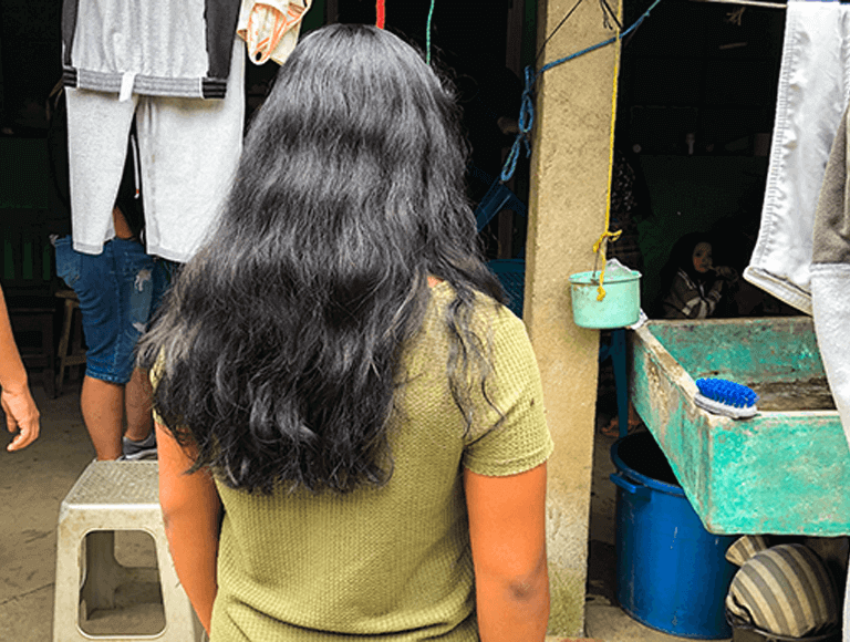 Image of girl with long hair from behind in Honduras
