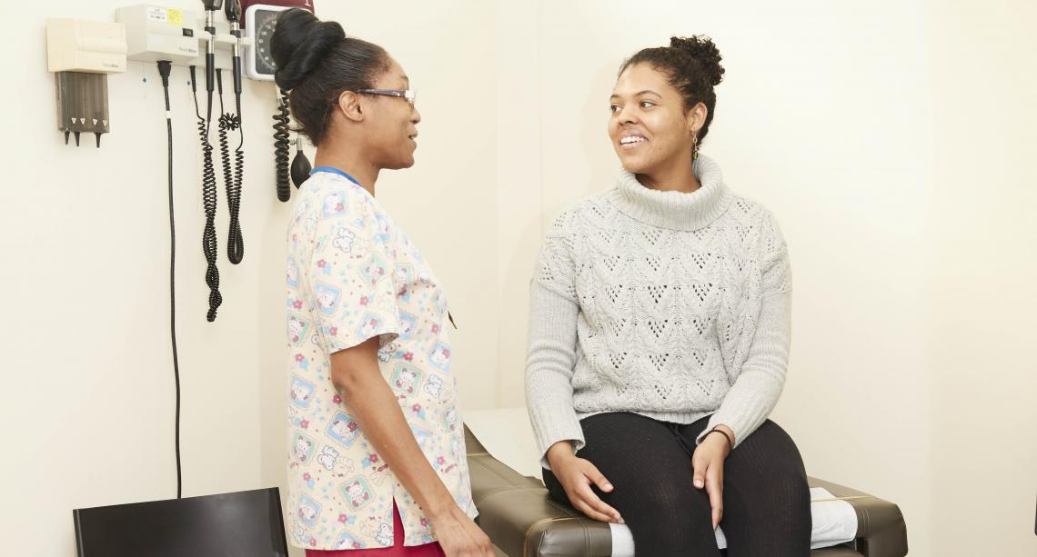 Girl speaking with nurse