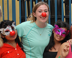 Woman with masked girls at La Alianza Guatemala